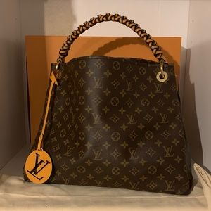 Louis Vuitton Artsy MM with braided strap.